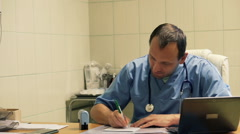 Male doctor writing rx prescription in hospital HD Stock Footage