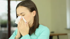Young woman having a flu and sneezing, close up  HD Stock Footage