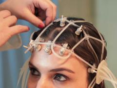 Doctor preparing  woman for brain scan in hospital NTSC - stock footage