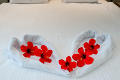 Heart made from towels on honeymoon bed Stock Photos