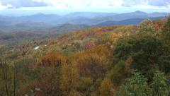 Linn cove viaduct in distance, blue ridge parkway overlook in the fall, nc Stock Footage