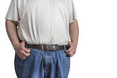 Overweight man in blue jeans and white shirt Stock Photos