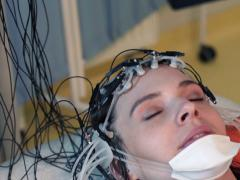 Woman in sleep having brain scan in hospital NTSC Stock Footage