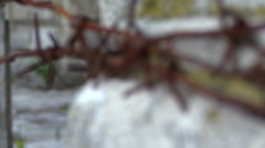 Slow focusing on coils of rusty barbed wire Stock Footage