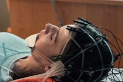Woman talking while having brain scan in hospital NTSC Stock Footage