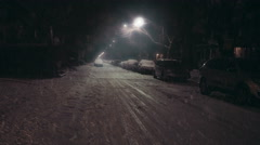 City street at night during a winter storm. Stock Footage