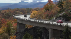 Cars drive over linn cove viaduct, blue ridge parkway in the fall, nc Stock Footage