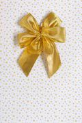 gold gift bow isolated - stock photo