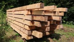 Wooden squared timbers for the building of a wooden house Stock Footage