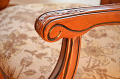 Detail of armrest an decorative wooden chair Stock Photos