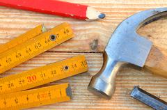 claw hammer, carpenter meter, pencil and chisel - stock photo