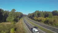 Stock Video Footage of  highway with cars in sunny day and wood. Aerial