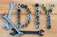 diy (do it yourself) text from small nuts and spanners - stock photo