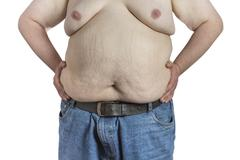 Shirtless overweight man Stock Photos