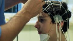 Doctor preparing teenager for brain scan in hospital HD Stock Footage