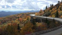 pan, linn cove viaduct, blue ridge parkway overlook in the fall, nc - stock footage
