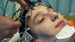 Doctor preparing teenager for brain scan in hospital HD Stock Footage