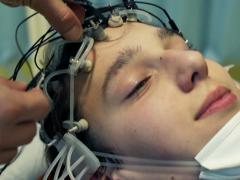 Doctor preparing teenager for brain scan in hospital NTSC Stock Footage