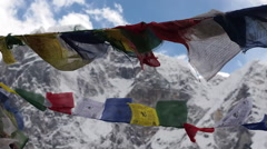 Prayer Flags Fluttering in the Wind with Himalayan Mountains in the Background Stock Footage