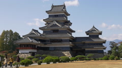 Visitors Approach Matsumoto Castle in Nagano, Japan - stock footage