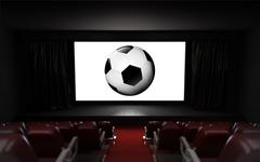 empty cinema auditorium with football advertisement on the screen - stock illustration