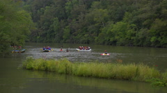 Kayaks and rafters on river - stock footage