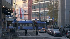 4K FHD Europe Germany Munich Tram in city downtown rushhour people crossing rail Stock Footage
