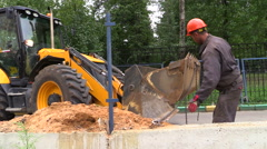 JCB tractor on the construction site moves concrete blocks. Stock Footage