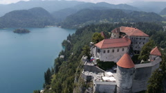 Aerial, slow motion - Bled Castle above the lake Stock Footage