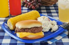 cheeseburger with corn on the cob - stock photo