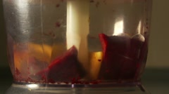 Carrots and beetroot are cut in electric a blender Stock Footage