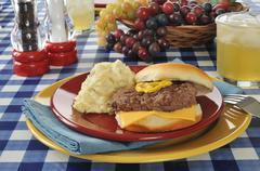 cheeseburger and potato salad - stock photo