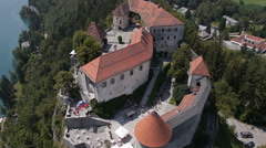Aerial, slow motion - Bled Castle with some visitors, top view Stock Footage