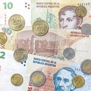 money from argentina, peso banknotes and coins. - stock photo