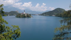 Aerial - Past the trees towards the church of Bled Stock Footage