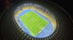 Amazing soccer stadium, glowing lights at night, aerial view, 4k Stock Footage