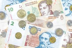 Money from argentina, peso banknotes and coins. Stock Photos