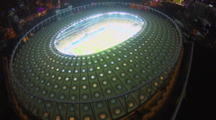Great illuminated stadium, sporting event, view from top, aerial Stock Footage