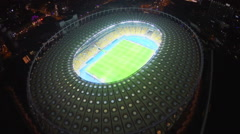 Illuminated football stadium, field and seating, view from above, click for HD - stock footage