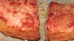 Rashers of bacon being fried in a pan Stock Footage