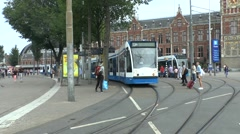 No 13 tram outside Centraal Station, Amsterdam, Netherlands. Stock Footage