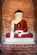 Buddha statue inside seinnyet ama pagoda ruins. ancient architecture of old b Stock Photos