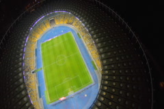 Great illuminated stadium from aerial perspective, football game, click for HD Stock Footage