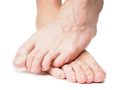 male feet one over the other - stock photo