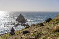 Stock Photo of United Kingdom, England, Cornwall, Land's End, Photographer photographing Armed