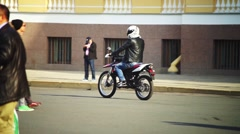 Motorcyclists On Red Bike Crosses Street Stock Footage