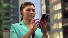 Female manager making a phone call with bluetooth device - stock footage