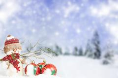 Stock Photo of christmas decorations against winter background