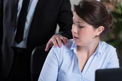 Workplace harassment Stock Photos