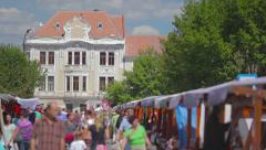 People walking on the street at a city festival Stock Footage